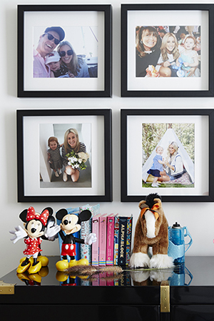 Family photos adorn pixie's bedroom walls