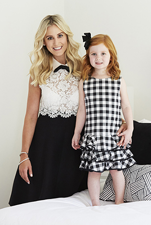 The mother-daughter duo in monochrome - Roxy wears valentino, pixie is in dolce & Gabbana