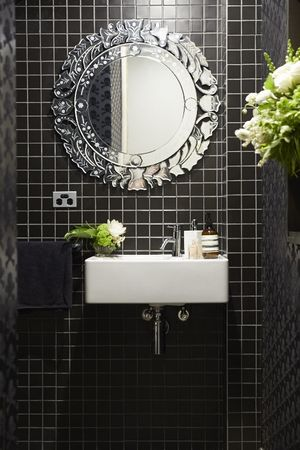 a beautiful bathroom with fresh blooms