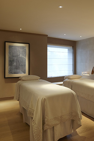 cosy pre-heated treatment beds await in the couples room