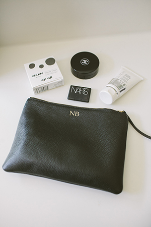 monochromatic beauty bag essentials; nars eyeshadow, chanel, chi khi and ultraceuticals