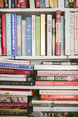 a collector of cookbooks; a slice of the comprehensive collection in her home office