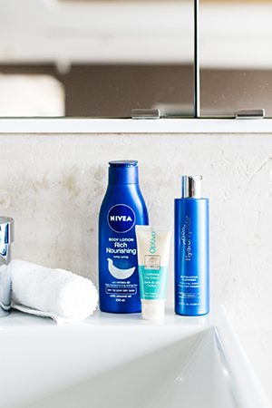 jess's hydropeptide cleanser, boots optiva day cream and nivea moisturiser on the vanity