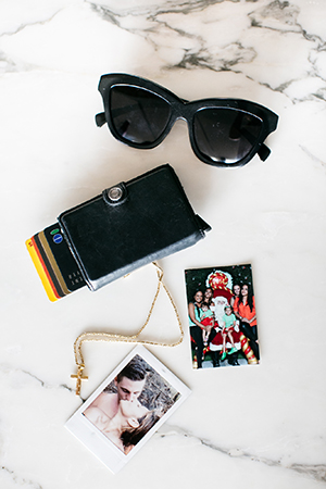 a few of the sentimental treasures in jess's bag including her secrid card holder