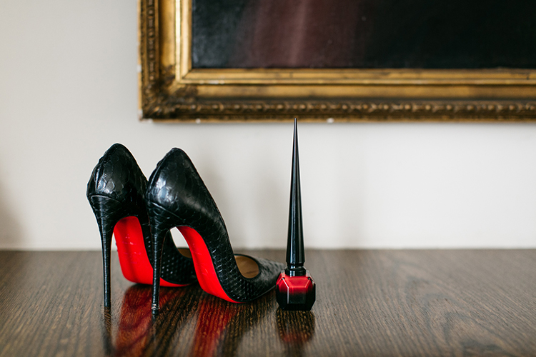 Her Louboutin heels and matching nail polish