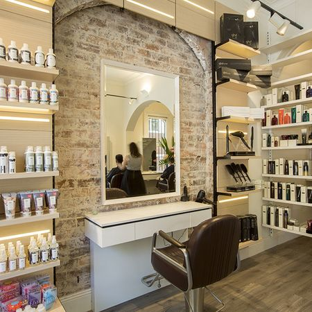 exposed brick gives the salon a look of edginess