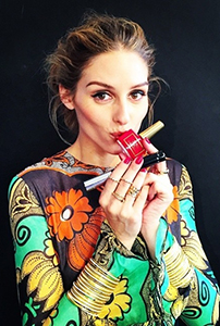 @oliviapalermo rocking her signature red mani