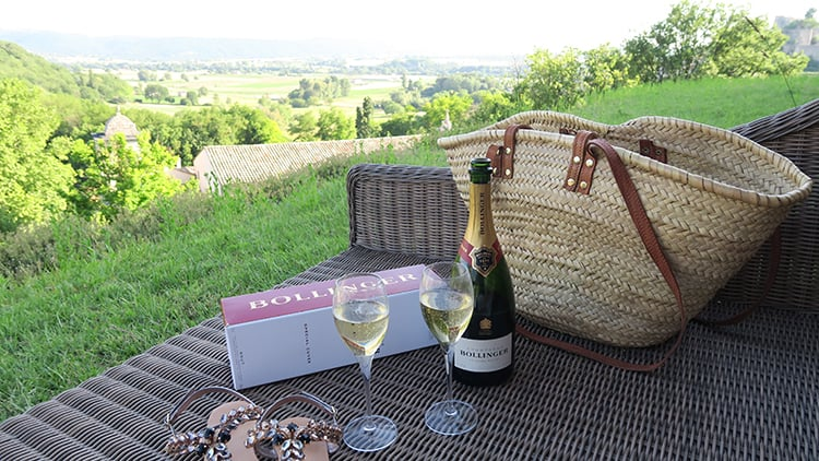 Sharing a bottle of Bollinger and local products is a great addition to the leafy backdrop