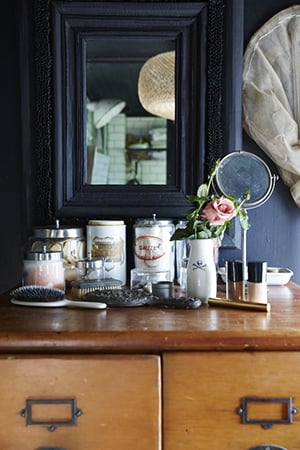 vintage mirrors and canisters on the dressing table