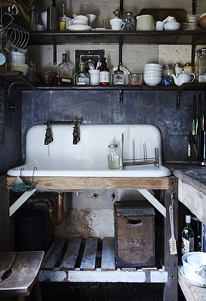 the kitchen boasts a  specially commissioned handmade sink and splashback