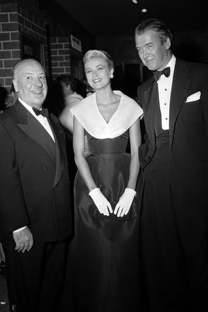 Grace Kelly with friend Alfred Hitchcock and co-star Jimmy Stewart at the premiere of Rear Window