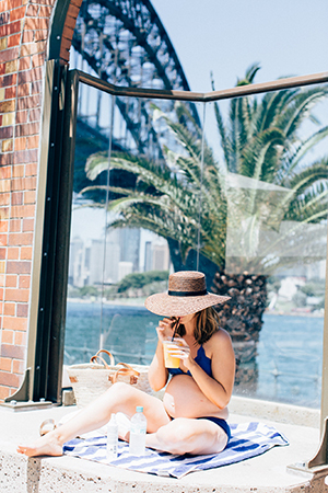 the harbour backdrop at the pool. sigourney wears 66thelabel hat