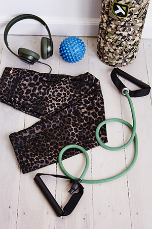 Her fitness must-haves: a resistance band, music, a massage ball and recovery roller.