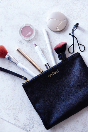 Her bag of beauty tricks includes a toothbrush for shaping eyebrows