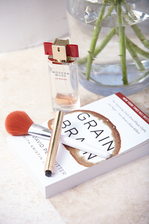 book worm; rachael's recent read, her fragrance and ysl touche eclat