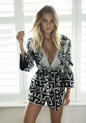 Elyse wears one of her faves: an Alice McCall Black and White playsuit