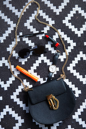 her favourite makeup staples spill from her chloe bag, along with dior sunnies and a chic watch