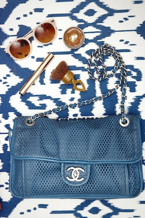 the day's essentials spill from Her gorgeous chanel shoulder bag