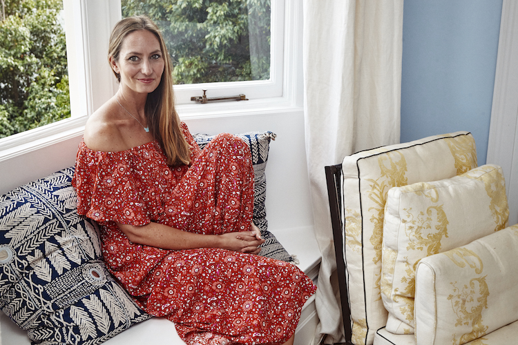 The mum of two is radiant in red against pops of colour in her abode