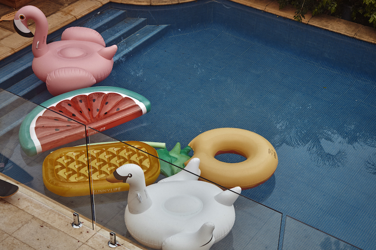 Floatie fun; flamingos, swans, watermelons and pineapples afloat in the pool