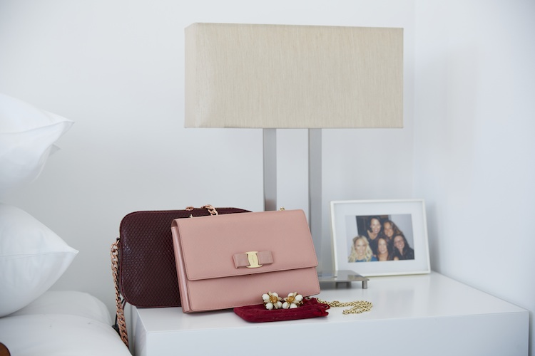 Her favourite Ferragamo clutch and photo of loved ones