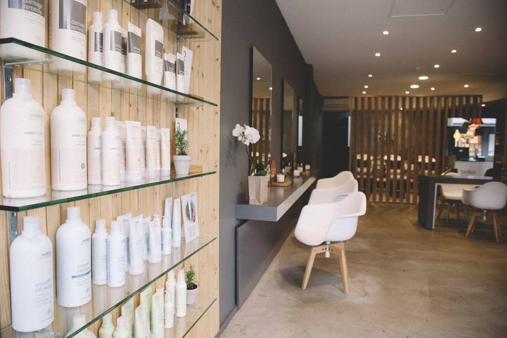 A library-esqu wall of beautiful Aveda products...