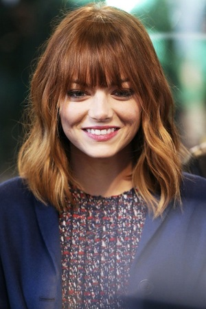 Screen grab for your stylist: The hair chameleon herself, Emma Stone, uses her natural wave to its full advantage. Image: Pinterest