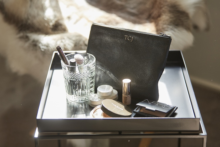 Her favourite beauty fare finds its home in her bespoke bag.