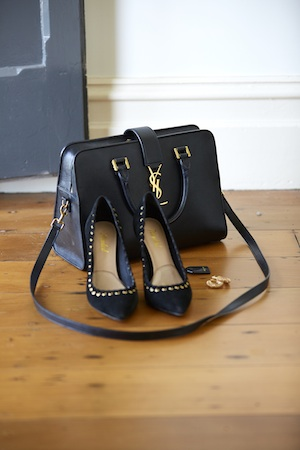 Your never fully dressed without a... YSL Bag, of course.