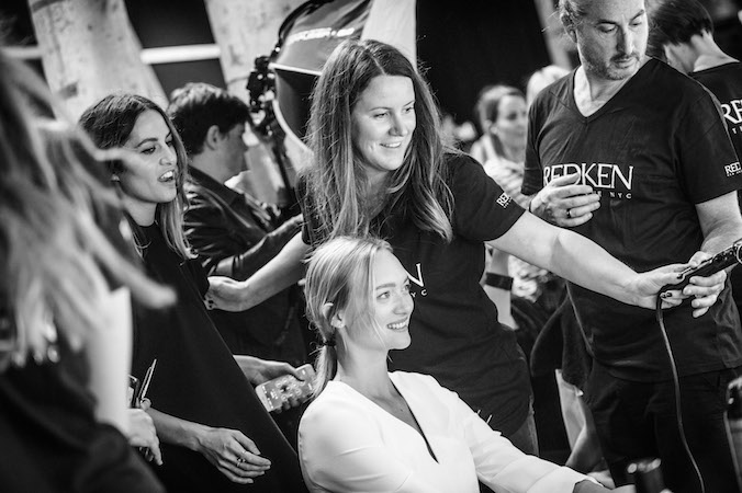 Michele showing us how it's done. Image Source: REDKEN