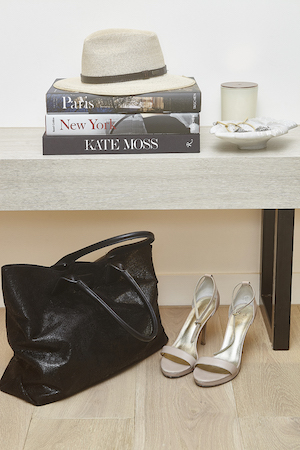 Ecoya candles and coffee table books are a chic way Sylvia dresses her and Pete's home
