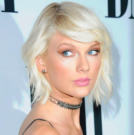 Taylor Swift with side-swept bangs and shoulder-grazing length
