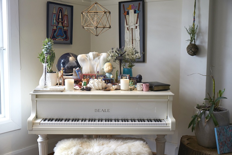 The beautiful piano is the stand-out feature in their home - Bambi learnt to play as a child