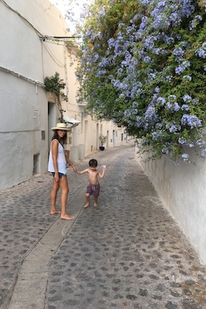 sigourney and max enjoying a stroll through dalt vila