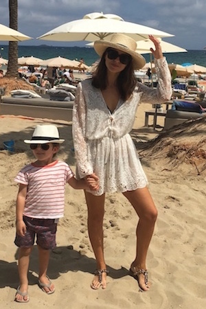 Sigourney wears Zimmermann playsuit, Max wears Cotton On Boardies and Tee