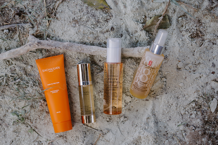 on the sand: Sachajuan hair in the sun, renutriv serum, mecca sunbrella and elizabeth arden 8 hour body oil