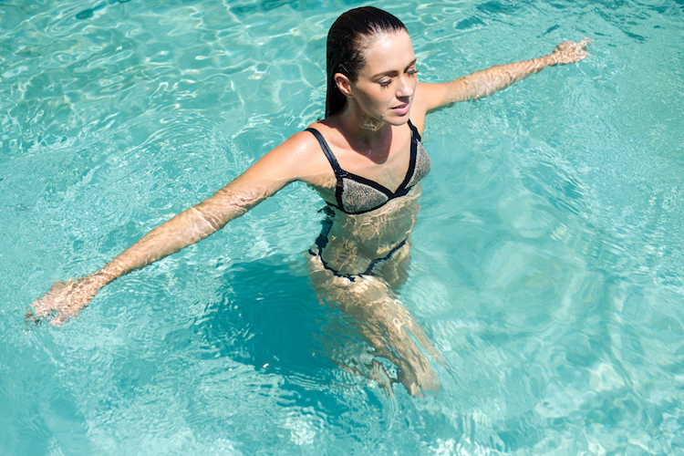 Sigourney testing waterproof products in ibiza; photo by ana lui