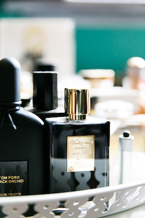 Fragrances have pride of place on a series of trays beside her desk.