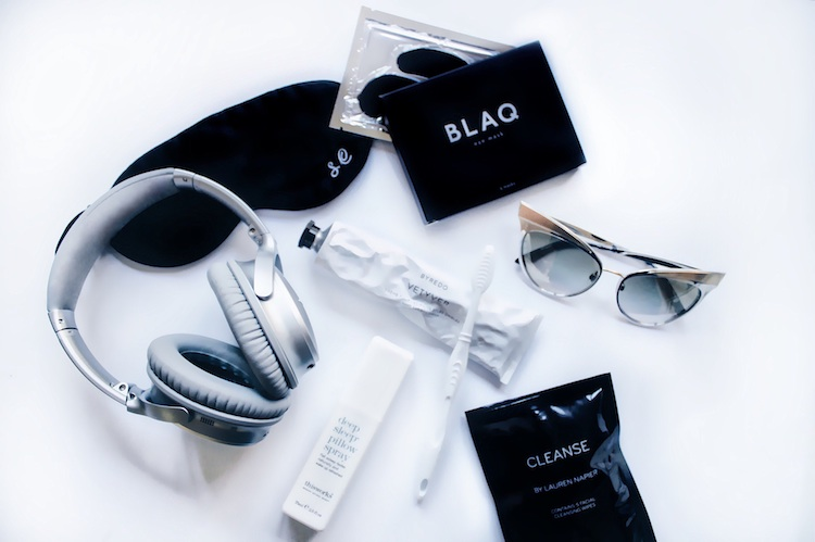 Essentials: Eye Mask; Bose Wireless Headphones, Blaq Eye Mask, Cleanse Towels and sunnies