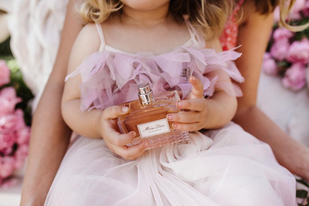 lulu wears tutu du monde and holds miss dior eau de parfum