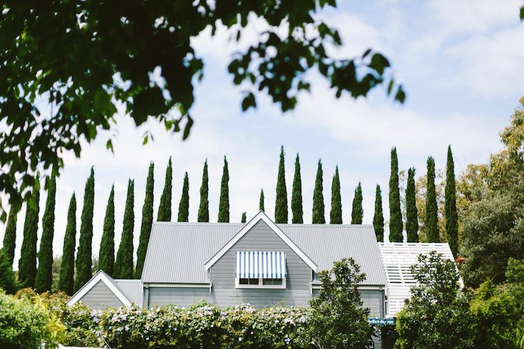 the pretty surrounds of bells features conifers and groomed gardens