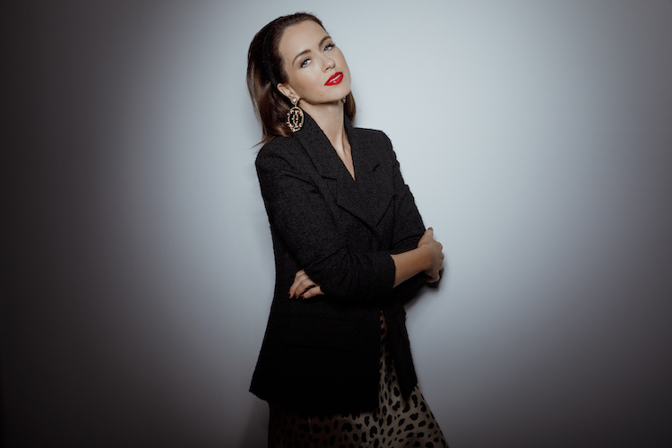 Sigourney wears Chanel Jacket and  earrings  and  Réalisation Par skirt .
