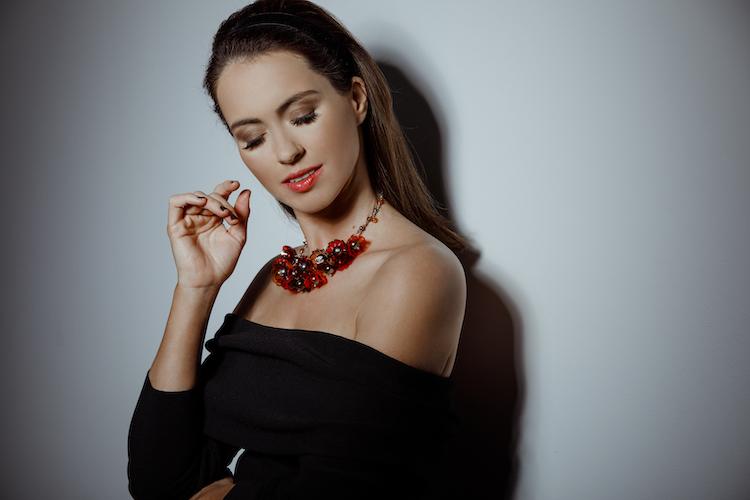 Sigourney wears Chanel necklace and Bec + Bridge top.