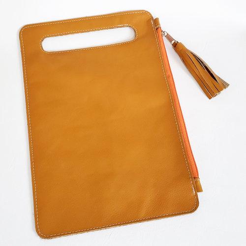 9c195508de Side Zip Tassel Clutch