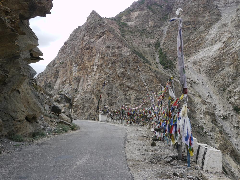 Prayer flags line the roadside.
