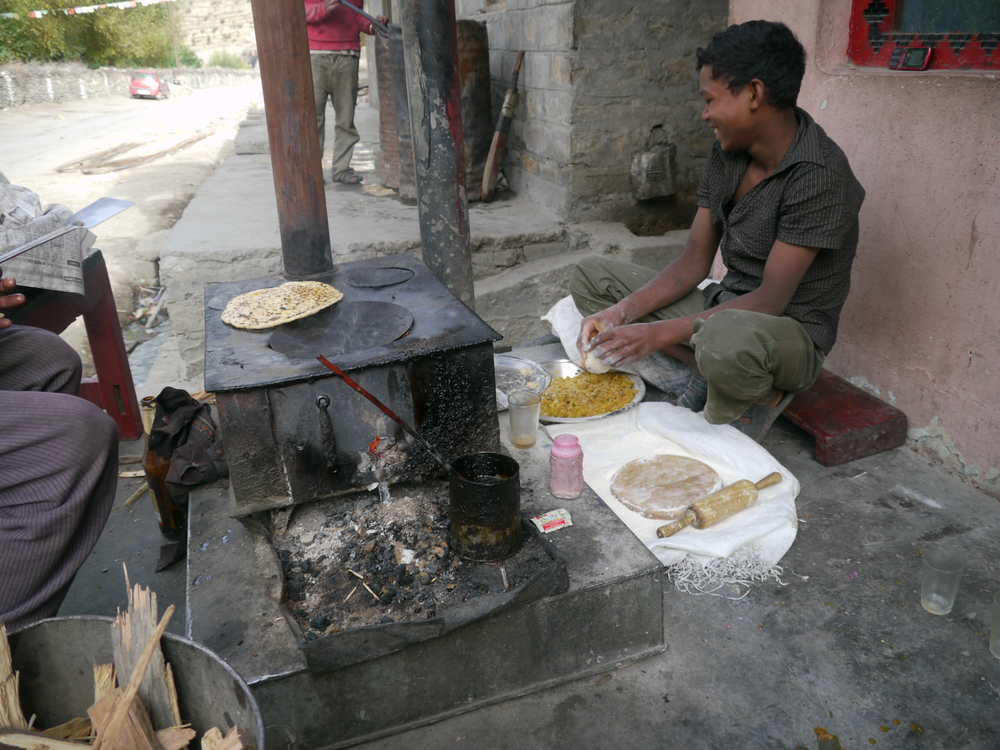 I would normally head off early in the morning and then stop for breakfast after about an hours ride. This is typical of a breakfast stop  Pranthas being cooked on the side of the road. Tasty and good cycling fuel. Washed down with a glass of Chai of course!
