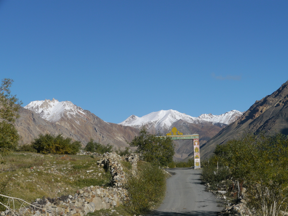 Leaving the town of Losar - snow capped peaks await.