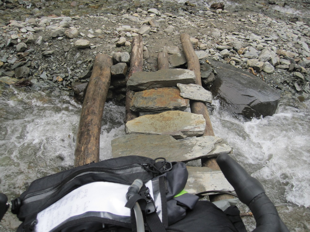 Plenty of obstacles along the road. This makeshift bridge allowed me to continue without getting my feet wet.