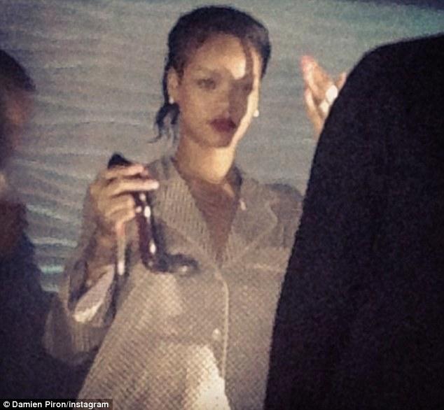 Rihanna sips stiletto 2.jpg