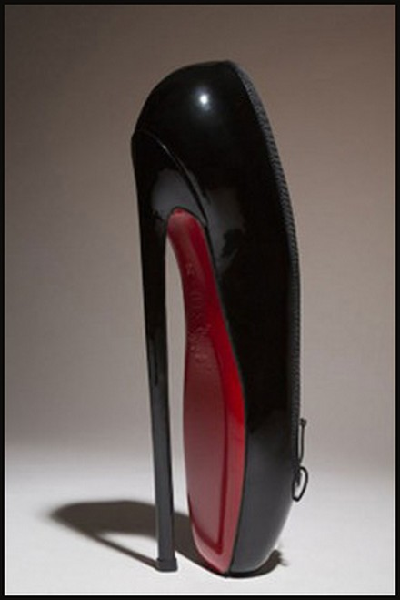 "Louboutin's version of the 19th Century ""Fetish"" Ballerina Boot"